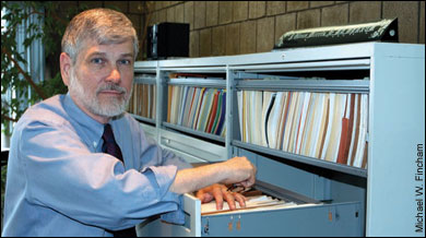 Glenn Morris in his office by file cabinets - by Michael W. Fincham