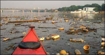 trash in the Anacostia River by Skip Brown