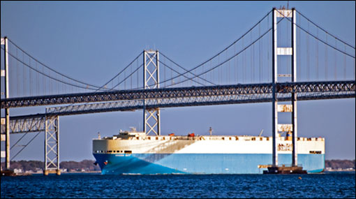 Cargo ship going under the Bay Bridge by Michael W. Fincham