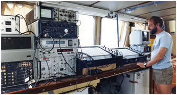 Steve Colman monitors on-board data-recording gear. Photograph courtesy of the U.S. Geological Survey
