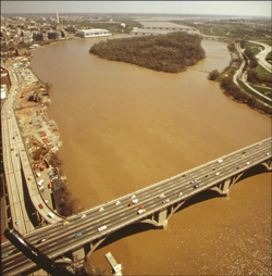 Tropical Storm Agnes sent massive loads of sediment flooding down the Potomac in June; in September the muddy water was still flowing past the Key Bridge in Georgetown. Credit: Dick Swanson from the U.S. Natinal Archives collection