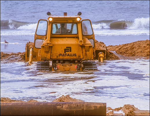 A bulldozer arranges sand. Photograph: David Harp,