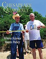 issue cover - Reading the tale of the tape measure are Maryland politicians Bernie Fowler, a former state senator, and Steny Hoyer, current U.S. congressman. The water clarity mark for June 14 at the 2015 Patuxent River Wade-In measured 44.5 inches of light penetration. The Wade-In, which focuses attention on the health of the river, has been conducted yearly since 1988. Photograph, Michael W. Fincham