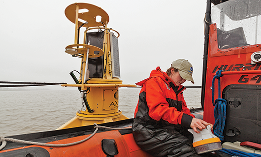 Katie Kirk servicing a buoy. Photograph courtesy Chesapeake Bay Program