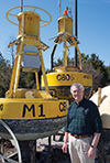 Bill Boicourt standing next to one of his CBOS buoys. Photograph, Daniel Pendick