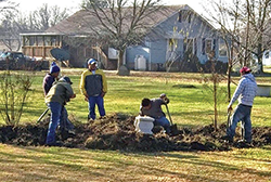 Workers at the Empowering Believers Church putting in a rain garden. Photograph, Interfaith Partners for the Chesapeake