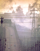 Dark clouds of factory smoke obscure Clark Avenue Bridge in Cleveland, Ohio, in 1973. Photograph, Frank J. Aleksandrowicz, National Archives and Records Administration collection