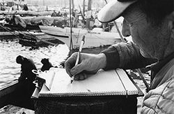 An oyster buyer records a day's catch. Photograph courtesy of the Chesapeake Bay Maritime Museum