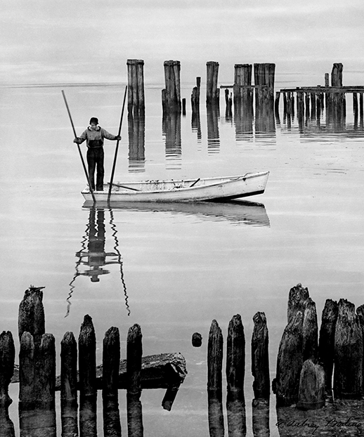 A. Aubrey Bodine got a waterman to move his skiff into position and pretend he was catching oysters. Photograph, A. Aubrey Bodine, copyright  Jennifer B. Bodine