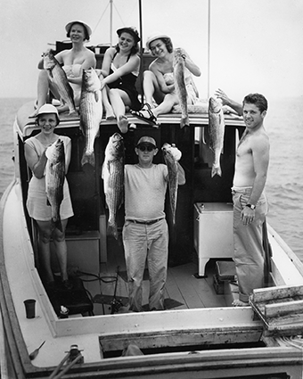 Near Annapolis, a rockfish party celebrates during the Chesapeake Bay Fishing Fair in the early 1950s. Photograph courtesy of Mame Warren