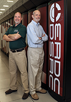 Carl Cerco and Mark Noel next to Garnet, a supercomputer. Photograph, Oscar Reihsmann, U.S. Army Corps of Engineers