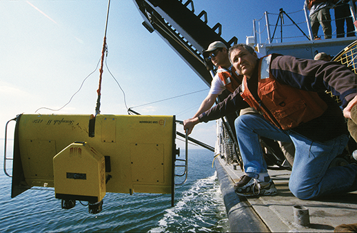 Oceanographer Bill Boicourt and research assistant Tom Wazniak lower a sampling device called a ScanFish. Photograph, Michael W. Fincham