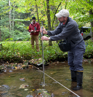 Keith Eshleman, forefront, made a surprising discovery several years ago: nitrogen concentrations in forested streams were dropping by large amounts, and that power plant standards Congress passed in 1990 were the main reason why. photograph, Cheryl Nemazie, UMCES