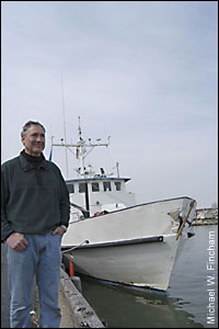 Bill Boicourt standing in from of the RV Cape Henlopen - by Michael W. Fincham
