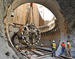 Pieces of a giant tunnel-boring machine are lowered and assembled underground. Credit: DC Water
