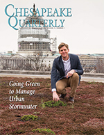 issue cover - John Hill crouches over a green roof overlooking the U.S. Capitol. His organization, the United Methodist General Board of Church and Society, installed the 6,800-square-foot vegetated roof in 2014 to reduce stormwater runoff and cut costs for air conditioning. Photograph, Skip Brown