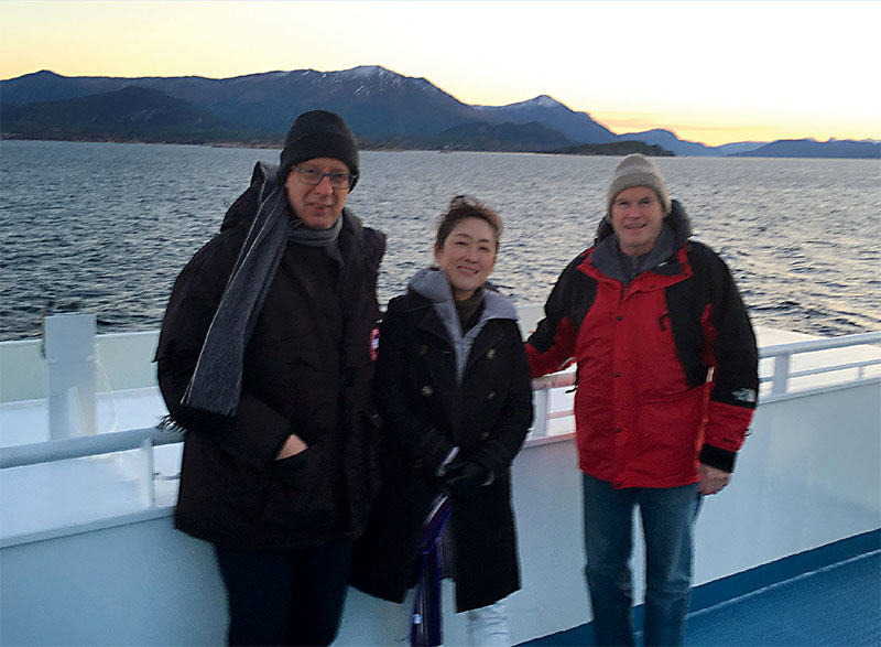 Yonathan Zohar, Keiko Saito, and Kevin Sowers on a boat in Norway. Photo courtesy of IMET