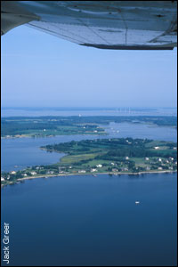 View of the Bay from the airplane showing Kent Island - by Jack Greer